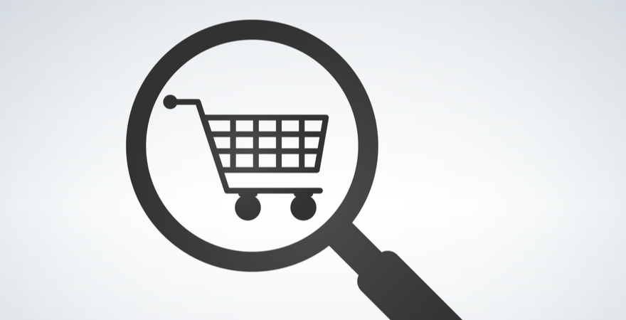 A vector image of a magnifying glass over a shopping trolley.